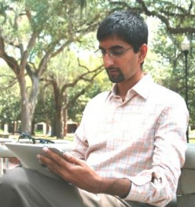 Staff using a tablet and wireless connectivity outside