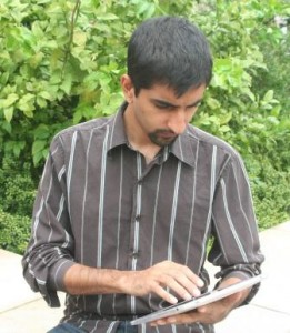 Staff member working outside on a tablet