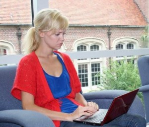 Postdoc using laptop in Pugh Hall