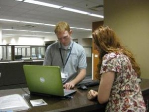 Student Getting Assistance with Laptop