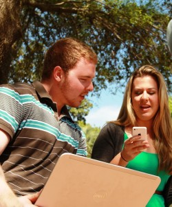 Students using mobile devices outside