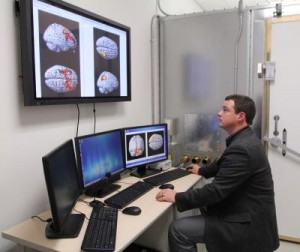 Dr. Adam Woods looking at brain scans