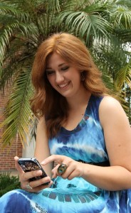 Woman using gatorcloud email on smartphone