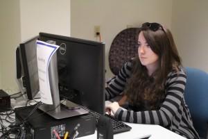 Female undergrad working at desktop PC