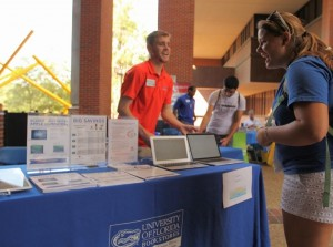Student talking to Bookstore staff at 2014 Tech Fair