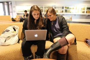 Two students watching a course lecture online