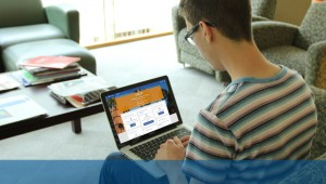 Student looking at ONE.UF homepage