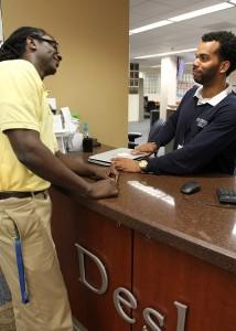 Help Desk supervisor assisting UF staff member