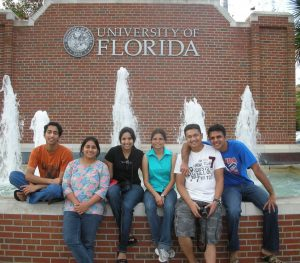 Students in front of fountain at 13th and University Ave.