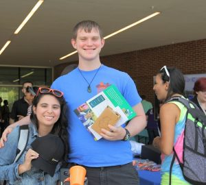 Photo: Two students holding the Swag they got at the 2016 Student Tech Fair
