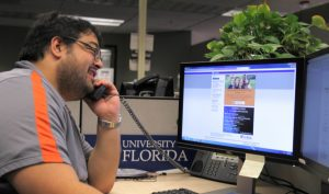 PHOTO: Member of UFIT's Workstation Support team helping a customer via phone.