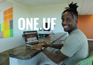 PHOTO: Student using the ONE.UF portal on his laptop
