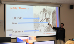 "PHOTO: Instructor reviewing daily info security threats during ""Cyber Security @ UF"" workshop."