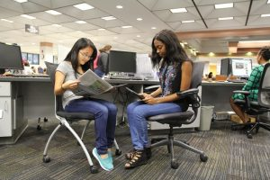 PHOTO: Two female students in Marston Science Library's Collaboration Commons