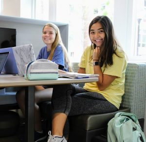 PHOTO: Two female students studying in Newell Hall.