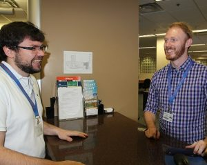 PHOTO: Two male staff members of the UF Computing Help Desk.