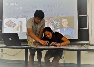 PHOTO: High school student Britney Chu demonstrating her project at the close of the 2017 Gator Computing Program.