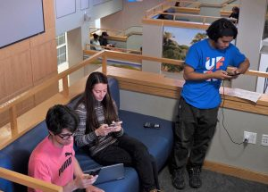 PHOTO: Students on mobile devices in Pugh Hall.