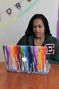 PHOTO: Female student using laptop in Hume Hall.