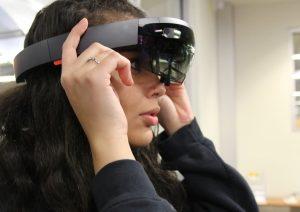PHOTO: Female student using virtual reality headset.