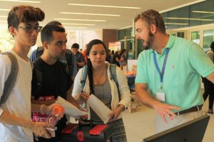 PHOTO: Students getting help at the ONE.UF table during the 2016 Tech Fair.