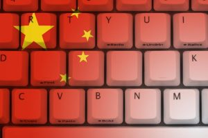 GRAPHIC: Computer keyboard with Chinese flag symbols on it.
