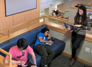 PHOTO: Students on mobile devices in Pugh Hall
