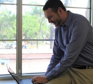 UF staff member using Zoom to connect to a meeting