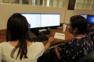 PHOTO: UFIT staff member helping a Ph.D. candidate with formatting her thesis