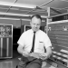 PHOTO: Black and white image of male employee in front of UF IBM computer circa 1965