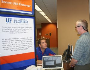 PHOTO: Staff turning in old devices that can store data, at the UF Computing Help Desk, 132 Hub