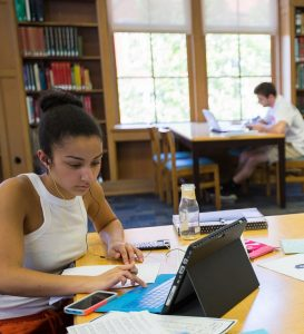 PHOTO: Students working on laptops in Smathers Library