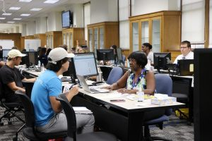 PHOTO: Students getting assistance at the Fall 2019 OneStop Service Center held in Smathers 100