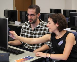 PHOTO: Instructional designer assisting faculty member at UFIT-CITT Open House Event, August 2019