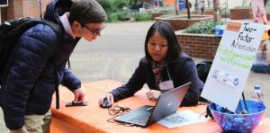 PHOTO: Student getting assistance onboarding in two-factor authentication while at the 2020 Student Tech Fair.