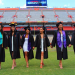 PHOTO: Female graduates posing on Florida Field in The Swamp