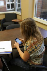 PHOTO: UF student using smartphone