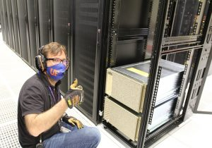 PHOTO: UFIT's Cory Devlin with installed NVIDIA GPUs in UF Data Center