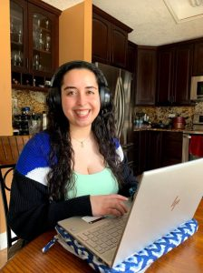 PHOTO: UF Computing Help Desk Student Supervisor Gabi Bitar answers calls from home