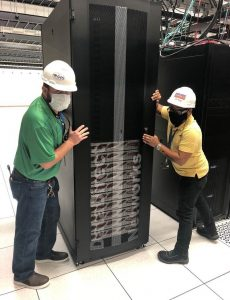 PHOTO: UFIT-ICT Data Center and Logistics staff members staging the first storage component of the HiPerGator AI system.
