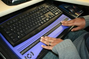 PHOTO: Student using a screen reader device in a Utah State University study