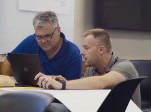 PHOTO: UFIT instructional designer helping a faculty member.