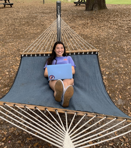 PHOTO: Female student in hammock, taken at University of Florida residence halls