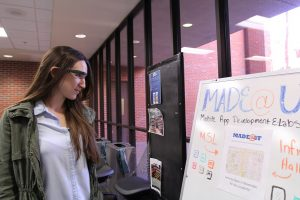 """PHOTO: Female student in UF Marston Library's """"MADEatUF"""" lab; University of Florida."""