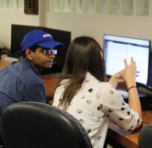 PHOTO: ETD staff member helping graduate student at the UF Computing Help Desk